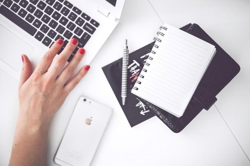 white-laptop-female-hand-note-pen-phone-desk (1)